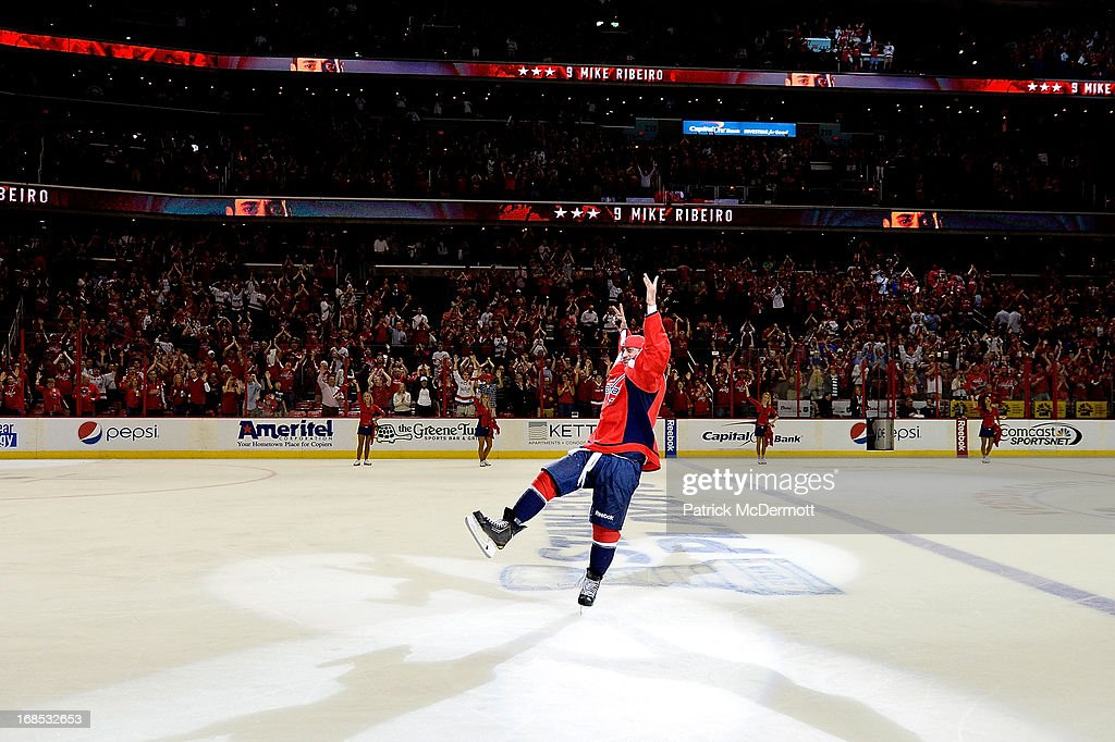 <a gi-track='captionPersonalityLinkClicked' href=/galleries/search?phrase=Mike+Ribeiro&family=editorial&specificpeople=203275 ng-click='$event.stopPropagation()'>Mike Ribeiro</a> #9 of the Washington Capitals celebrates after scoring the overtime game winning goal in Game Five of the Eastern Conference Quarterfinals during the 2013 NHL Stanley Cup Playoffs against the New York Rangers at Verizon Center on May 10, 2013 in Washington, DC. The Capitals defeated the Rangers 2-1