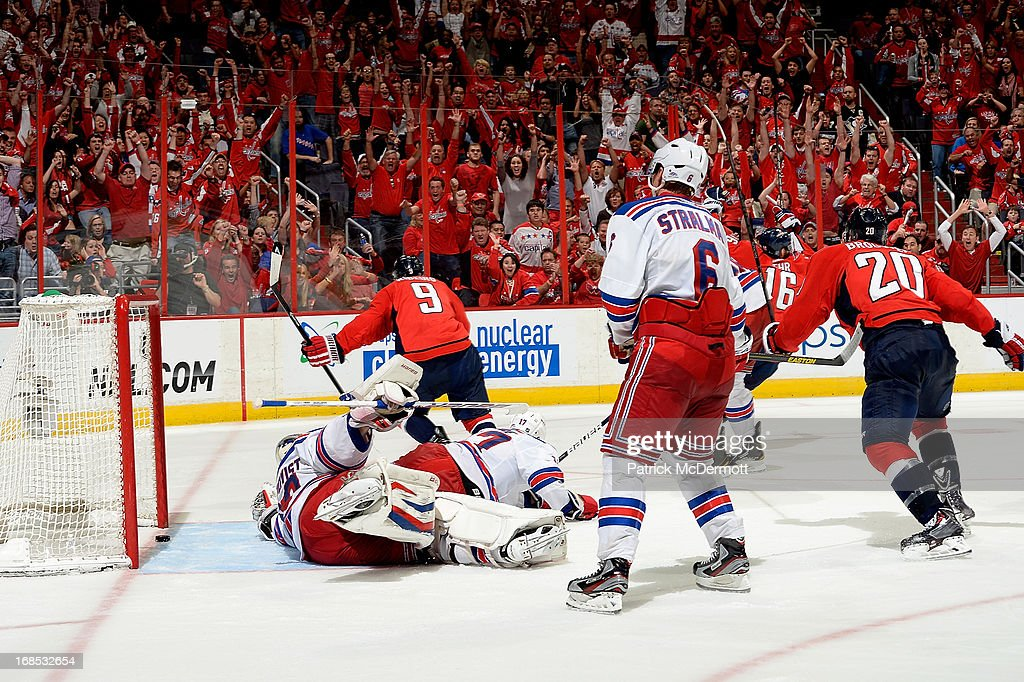 <a gi-track='captionPersonalityLinkClicked' href=/galleries/search?phrase=Mike+Ribeiro&family=editorial&specificpeople=203275 ng-click='$event.stopPropagation()'>Mike Ribeiro</a> #9 of the Washington Capitals celebrates after scoring the overtime game winning goal in Game Five of the Eastern Conference Quarterfinals during the 2013 NHL Stanley Cup Playoffs against the New York Rangers at Verizon Center on May 10, 2013 in Washington, DC. The Capitals defeated the Rangers 2-1.