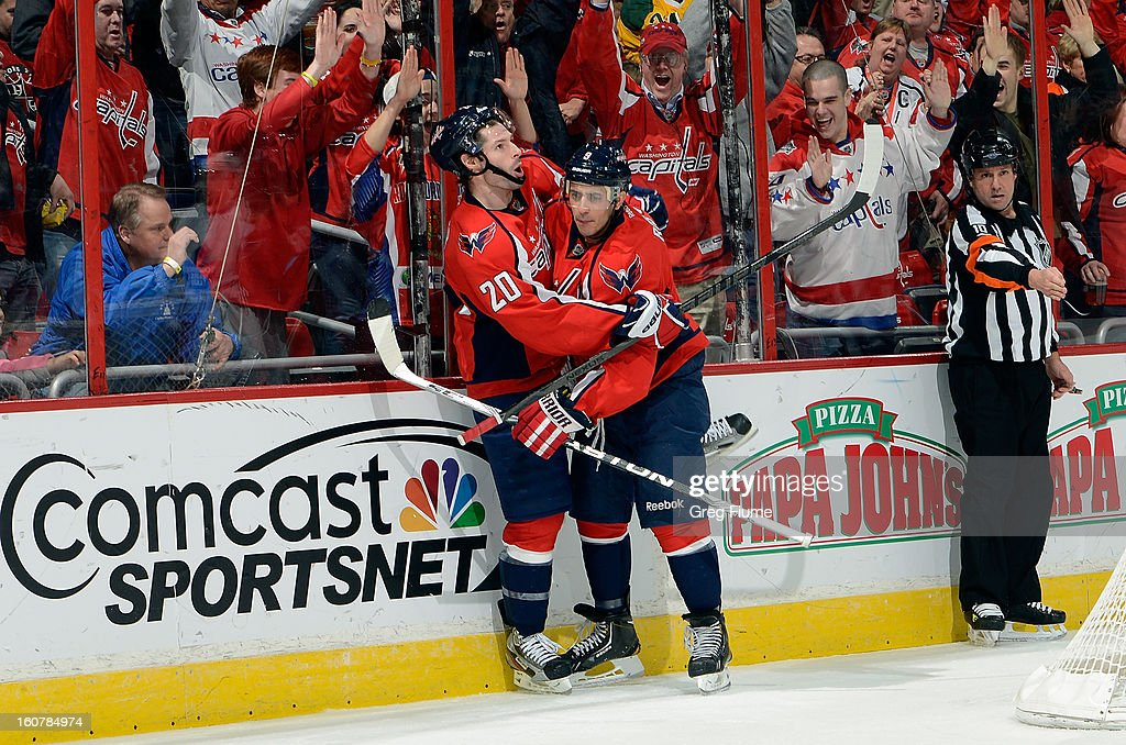 <a gi-track='captionPersonalityLinkClicked' href=/galleries/search?phrase=Mike+Ribeiro&family=editorial&specificpeople=203275 ng-click='$event.stopPropagation()'>Mike Ribeiro</a> #9 of the Washington Capitals celebrates with <a gi-track='captionPersonalityLinkClicked' href=/galleries/search?phrase=Troy+Brouwer&family=editorial&specificpeople=4155305 ng-click='$event.stopPropagation()'>Troy Brouwer</a> #20 after scoring in the third period against the Toronto Maple Leafs at the Verizon Center on February 5, 2013 in Washington, DC.