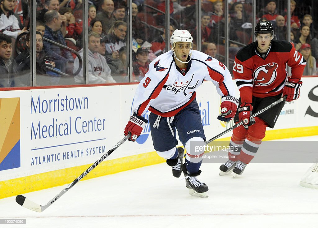 <a gi-track='captionPersonalityLinkClicked' href=/galleries/search?phrase=Mike+Ribeiro&family=editorial&specificpeople=203275 ng-click='$event.stopPropagation()'>Mike Ribeiro</a> #9 of the Washington Capitals skates against Mark Fayne #29 of the New Jersey Devils during the game on January 25, 2013 at the Prudential Center in Newark, New Jersey.
