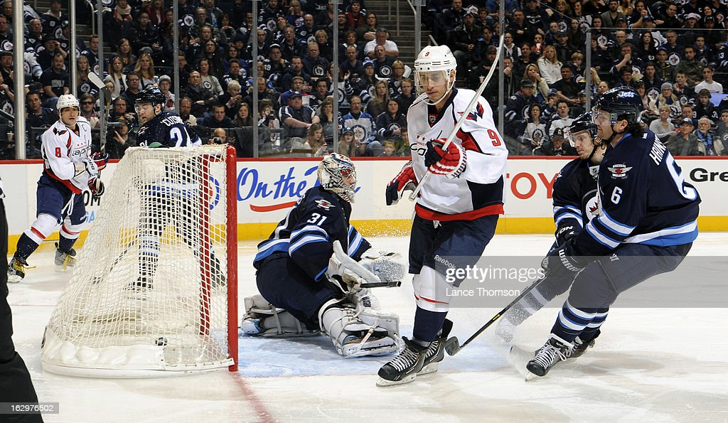 <a gi-track='captionPersonalityLinkClicked' href=/galleries/search?phrase=Mike+Ribeiro&family=editorial&specificpeople=203275 ng-click='$event.stopPropagation()'>Mike Ribeiro</a> #9 of the Washington Capitals skates past the net after tipping in a third period goal past goaltender Ondrej Pavelec #31 of the Winnipeg Jets at the MTS Centre on March 2, 2013 in Winnipeg, Manitoba, Canada.