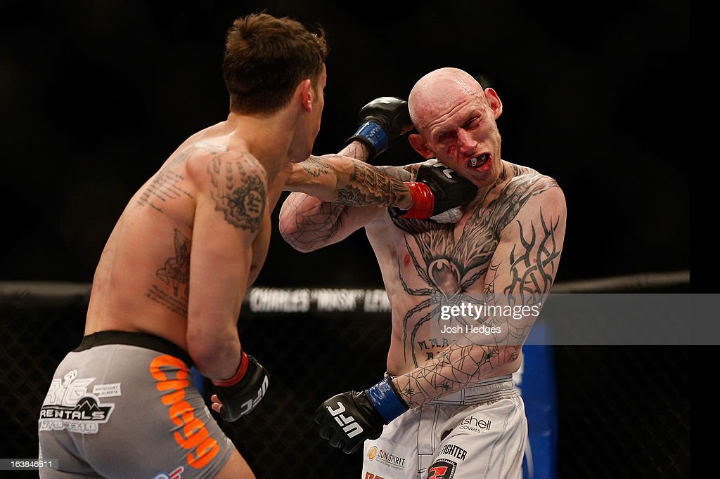 Mike Ricci lands a punch against Colin Fletcher in their lightweight bout during the UFC 158 event at Bell Centre on March 16, 2013 in Montreal, Quebec, Canada.