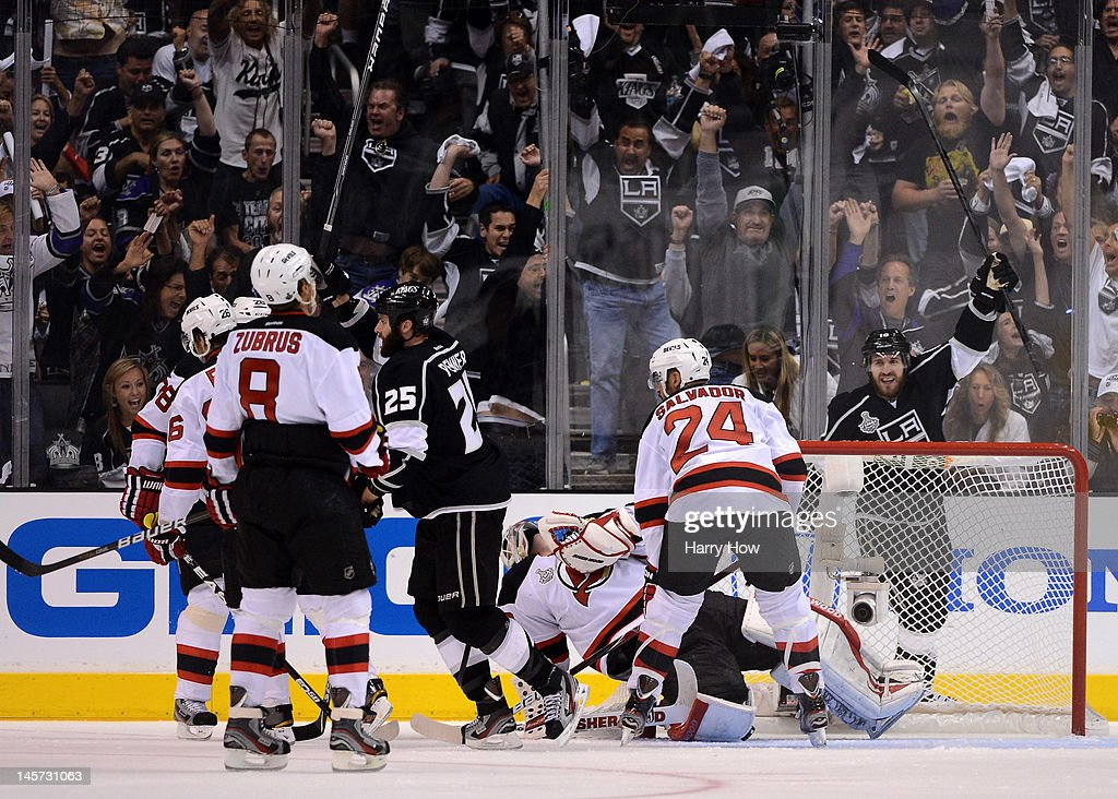 Mike Richards #10 and <a gi-track='captionPersonalityLinkClicked' href=/galleries/search?phrase=Dustin+Penner&family=editorial&specificpeople=589919 ng-click='$event.stopPropagation()'>Dustin Penner</a> #25 of the Los Angeles Kings react after a goal by teammate Jeff Carter #77 (not in photo) in Game Three of the 2012 Stanley Cup Final against the New Jersey Devils at Staples Center on June 4, 2012 in Los Angeles, California.