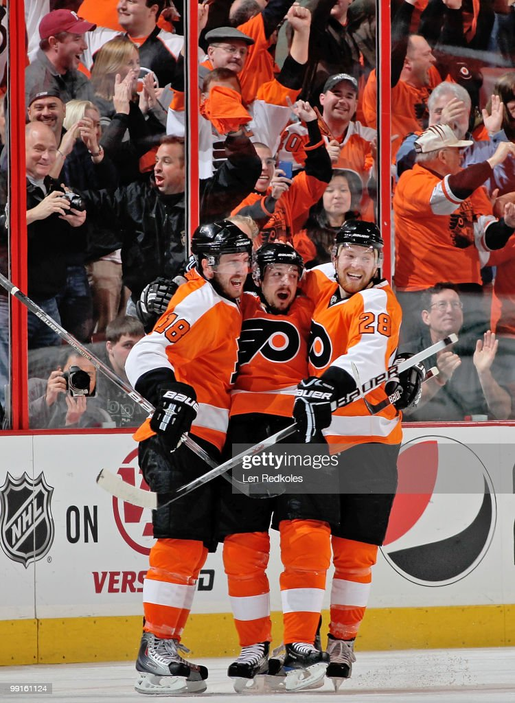 Mike Richards #18, Danny Briere #48, and Claude Giroux #28 of the Philadelphia Flyers celebrate Briere's second-period goal against the Boston Bruins in Game Six of the Eastern Conference Semifinals during the 2010 NHL Stanley Cup Playoffs at the Wachovia Center on May 12, 2010 in Philadelphia, Pennsylvania.