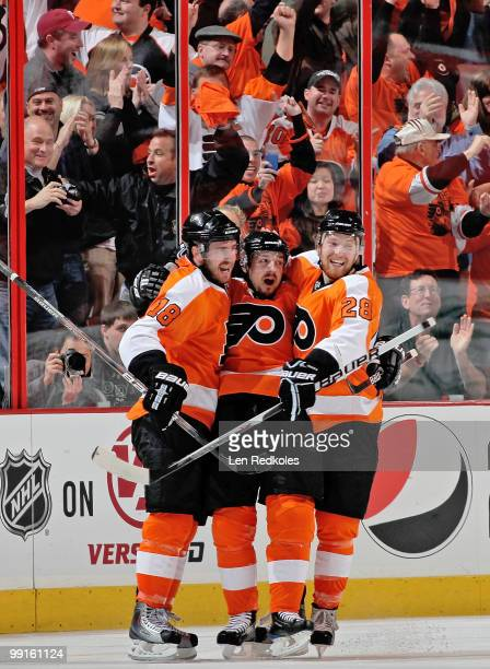 Mike Richards Danny Briere and Claude Giroux of the Philadelphia Flyers celebrate Briere's secondperiod goal against the Boston Bruins in Game Six of...