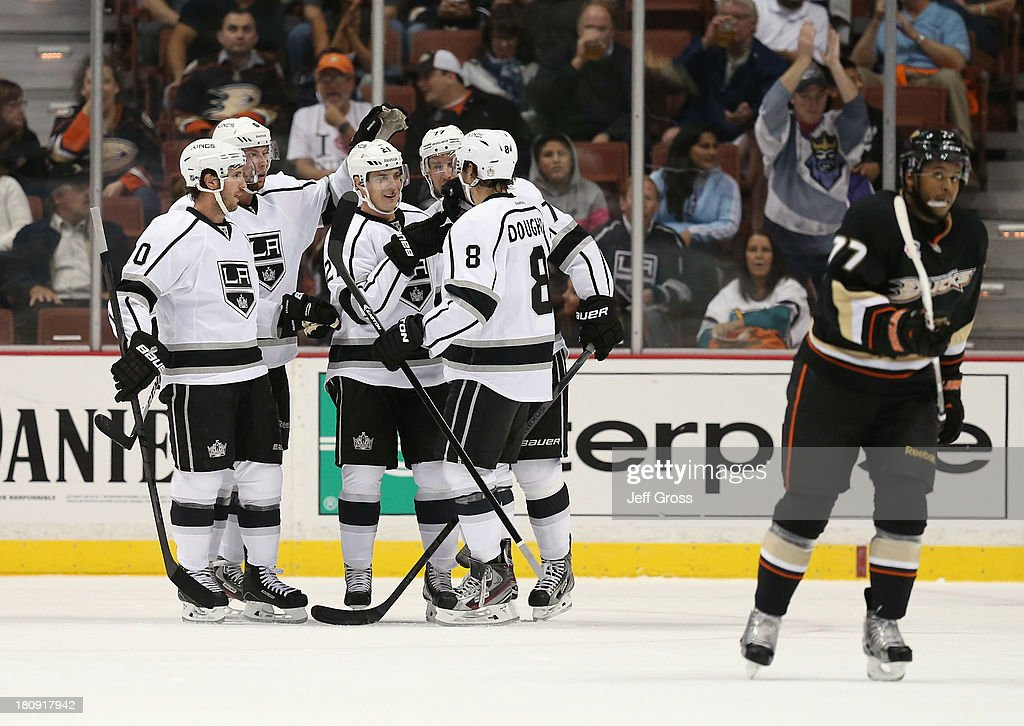Mike Richards #10, <a gi-track='captionPersonalityLinkClicked' href=/galleries/search?phrase=Jake+Muzzin&family=editorial&specificpeople=7205557 ng-click='$event.stopPropagation()'>Jake Muzzin</a> #6, <a gi-track='captionPersonalityLinkClicked' href=/galleries/search?phrase=Matt+Frattin&family=editorial&specificpeople=5648435 ng-click='$event.stopPropagation()'>Matt Frattin</a> #21, <a gi-track='captionPersonalityLinkClicked' href=/galleries/search?phrase=Jeff+Carter&family=editorial&specificpeople=227320 ng-click='$event.stopPropagation()'>Jeff Carter</a> #77 and <a gi-track='captionPersonalityLinkClicked' href=/galleries/search?phrase=Drew+Doughty&family=editorial&specificpeople=2085761 ng-click='$event.stopPropagation()'>Drew Doughty</a> #8 of the Los Angeles Kings celebrate Frattin's first period goal against the Anaheim Ducks at Honda Center on September 17, 2013 in Anaheim, California.