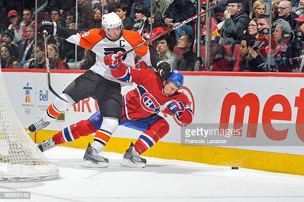 Mike Richards of Philadelphia Flyers collides with Travis Moen of Montreal Canadiens during the NHL game on February 13 2010 at the Bell Center in...