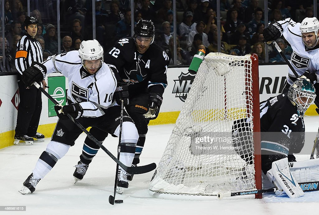 Mike Richards #10 of the Los Angeles King attacks the goal from behind the net keeping the puck away from <a gi-track='captionPersonalityLinkClicked' href=/galleries/search?phrase=Patrick+Marleau&family=editorial&specificpeople=203165 ng-click='$event.stopPropagation()'>Patrick Marleau</a> #12 of the San Jose Sharks in the first period in Game Five of the First Round of the 2014 NHL Stanley Cup Playoffs at SAP Center on April 26, 2014 in San Jose, California. The Kings won the game 3-0.
