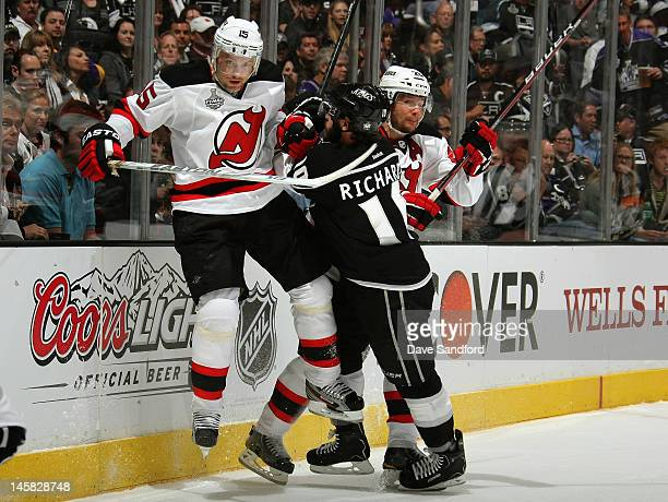 Mike Richards of the Los Angeles Kings checks Petr Sykora and Patrik Elias of the New Jersey Devils during the first period of Game Four of the 2012...