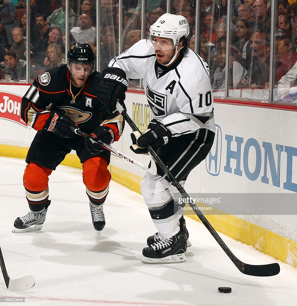 Mike Richards #10 of the Los Angeles Kings handles the puck against <a gi-track='captionPersonalityLinkClicked' href=/galleries/search?phrase=Saku+Koivu&family=editorial&specificpeople=202253 ng-click='$event.stopPropagation()'>Saku Koivu</a> #11 of the Anaheim Ducks on February 2, 2013 at Honda Center in Anaheim, California.