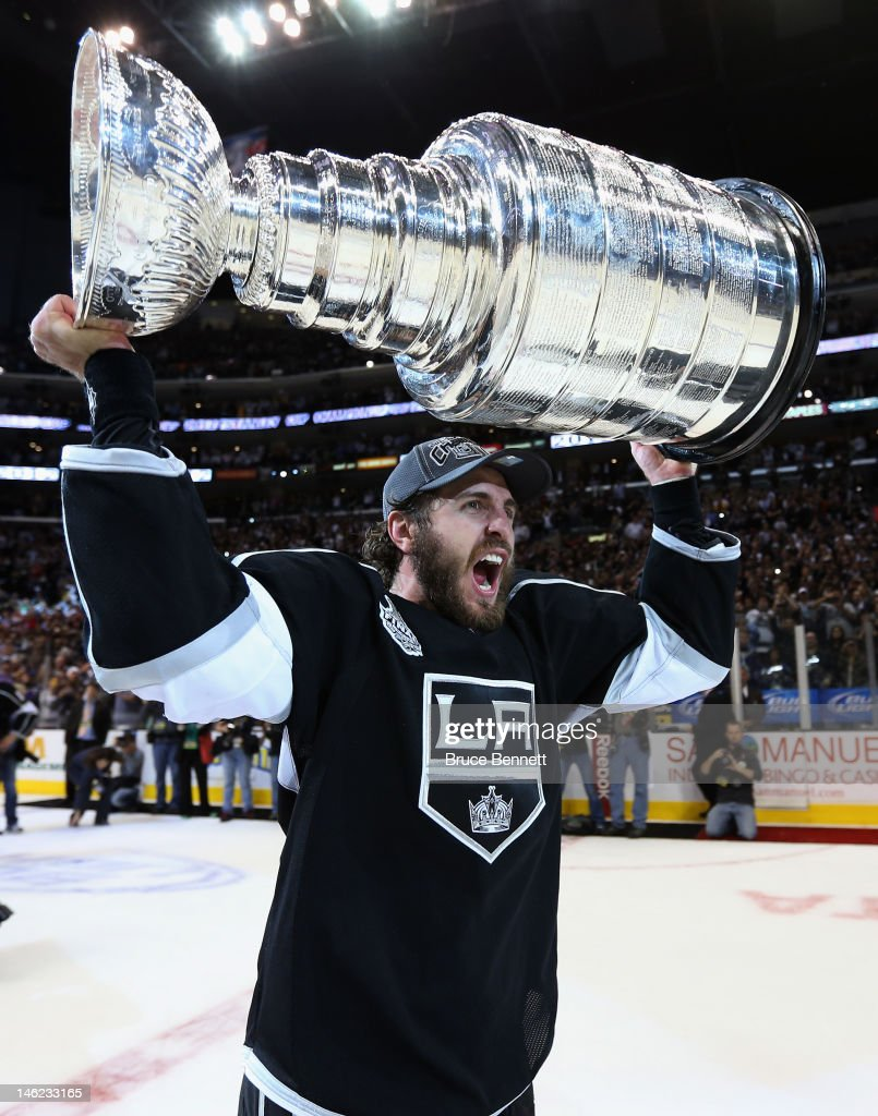 Mike Richards #10 of the Los Angeles Kings holds up the Stanley Cup after the Kings defeated the New Jersey Devils 6-1 to win the Stanley Cup series 4-2 in Game Six of the 2012 Stanley Cup Final at Staples Center on June 11, 2012 in Los Angeles, California.