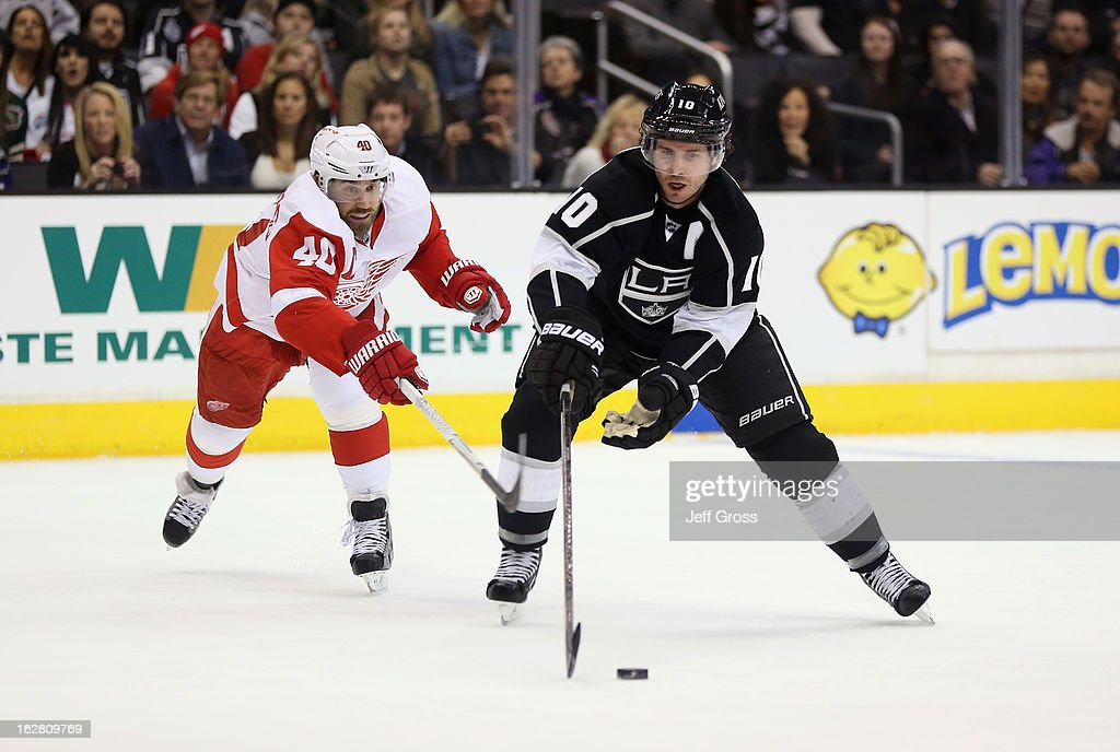 Mike Richards #10 of the Los Angeles Kings is pursued by Henrik Zetterberg #40 of the Detroit Red Wings in the second period at Staples Center on February 27, 2013 in Los Angeles, California.