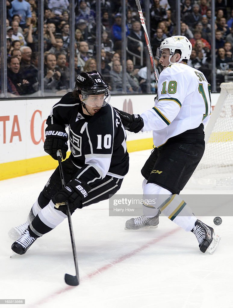 Mike Richards #10 of the Los Angeles Kings looks back for the puck behind Reilly Smith #18 of the Dallas Stars during the second period at Staples Center on March 7, 2013 in Los Angeles, California.