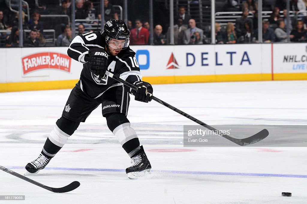 Mike Richards #10 of the Los Angeles Kings passes the puck against the Columbus Blue Jackets at Staples Center on February 15, 2013 in Los Angeles, California.