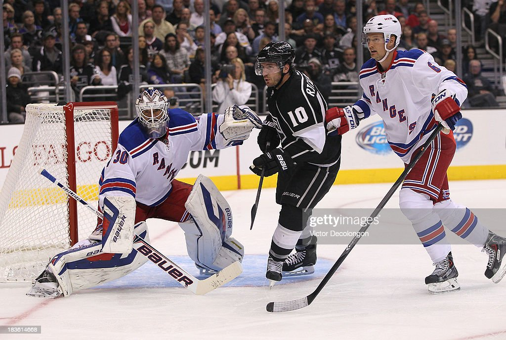 Mike Richards #10 of the Los Angeles Kings skates through the crease area between goaltender <a gi-track='captionPersonalityLinkClicked' href=/galleries/search?phrase=Henrik+Lundqvist&family=editorial&specificpeople=217958 ng-click='$event.stopPropagation()'>Henrik Lundqvist</a> #30 and defenseman <a gi-track='captionPersonalityLinkClicked' href=/galleries/search?phrase=Anton+Stralman&family=editorial&specificpeople=2271901 ng-click='$event.stopPropagation()'>Anton Stralman</a> #6 of the New York Rangers in the second period during their NHL game at Staples Center on October 7, 2013 in Los Angeles, California. The Rangers defeated the Kings 3-1.