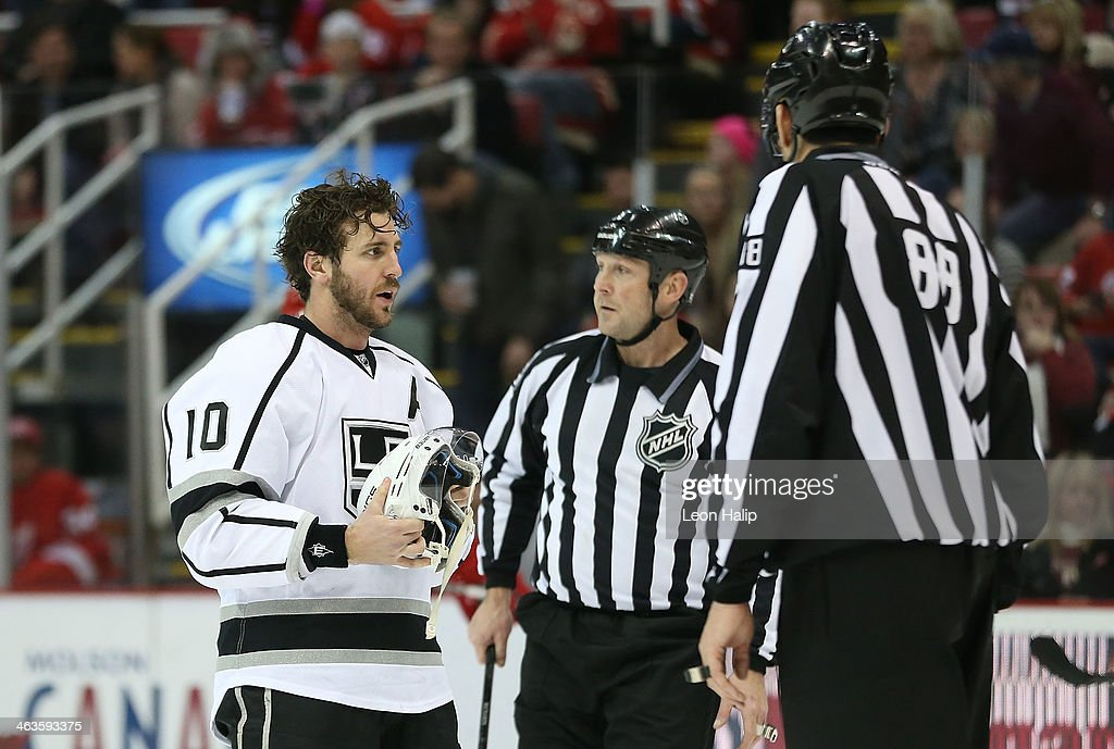 Mike Richards #10 of the Los Angeles Kings talks with the linesmen during the third period of the game against the Detroit Red Wings at Joe Louis Arena on January 18, 2014 in Detroit, Michigan. The Wings defeated the Kings 3-2 in a shootout.