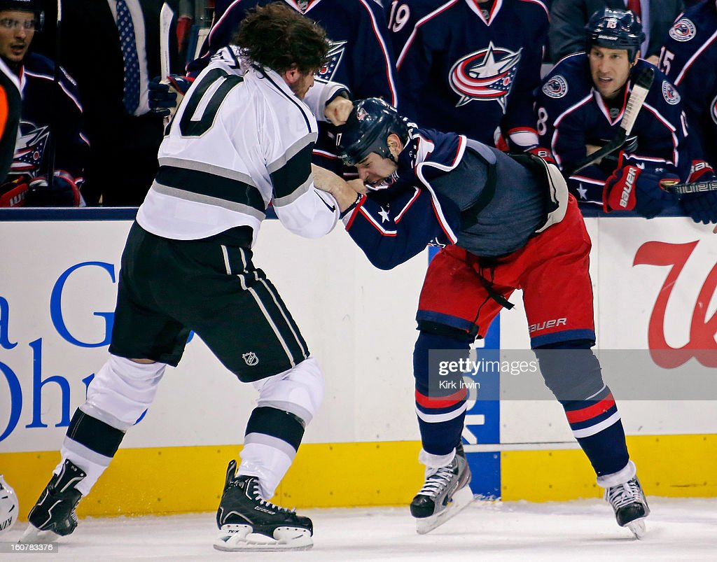 Mike Richards #10 of the Los Angeles Kings throws a punch while fighting with Brandon Dubinsky #17 of the Columbus Blue Jackets during the second period on February 5, 2013 at Nationwide Arena in Columbus, Ohio.