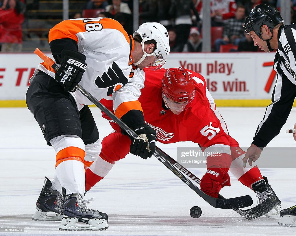 Mike Richards #18 of the Philadelphia Flyers faces off against Valtteri Filppula #51 of the Detroit Red Wings during an NHL game at Joe Louis Arena on January 2, 2011 in Detroit, Michigan. Flyers beat Wings 3-2