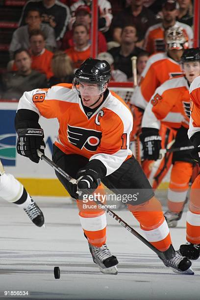 Mike Richards of the Philadelphia Flyers skates with the puck during the game against the Pittsburgh Penguins at the Wachovia Center on October 8...