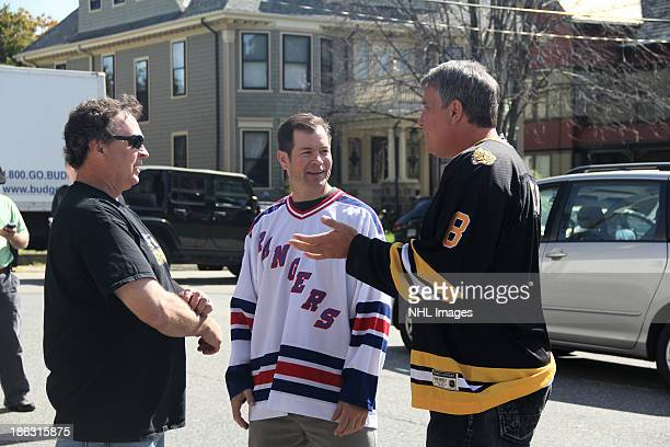 Mike Richter of the New York Rangers and Cam Neely of the Boston Bruins talk with film director Bobby Farrelly on the set of the 2013 Discover NHL...