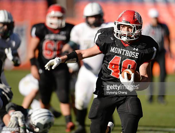 Mike Rocha of Montrose High School is rushing against Pine Creek High School defense during 4A State Football Championship game at Sports Authority...