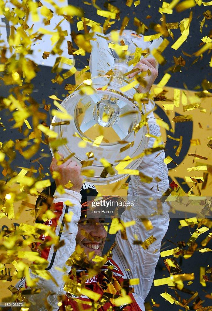 Mike Rockenfeller of Germany Audi Sport Team Phoenix celebrates after winning the DTM 2013 German Touring Car Championship at Hockenheimring on October 20, 2013 in Hockenheim, Germany.