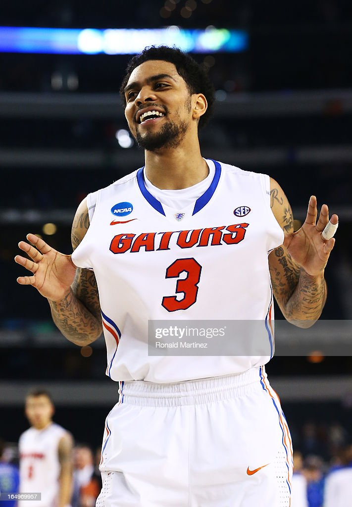 Mike Rosario #3 of the Florida Gators celebrates their 62 to 50 win over the Florida Gulf Coast Eagles during the South Regional Semifinal round of the 2013 NCAA Men's Basketball Tournament at Dallas Cowboys Stadium on March 29, 2013 in Arlington, Texas.