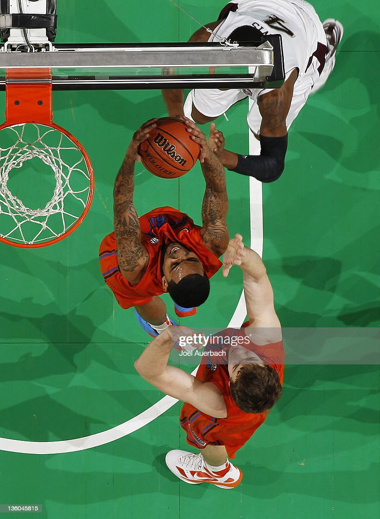 Mike Rosario #3 of the Florida Gators secures the defensive rebound from <a gi-track='captionPersonalityLinkClicked' href=/galleries/search?phrase=Keith+Davis&family=editorial&specificpeople=580211 ng-click='$event.stopPropagation()'>Keith Davis</a> #4 of the Texas A&M Aggies at the Orange Bowl Basketball Classic on December 17, 2010 at the BankAtlantic Center in Sunrise, Florida. Florida defeated Texas A