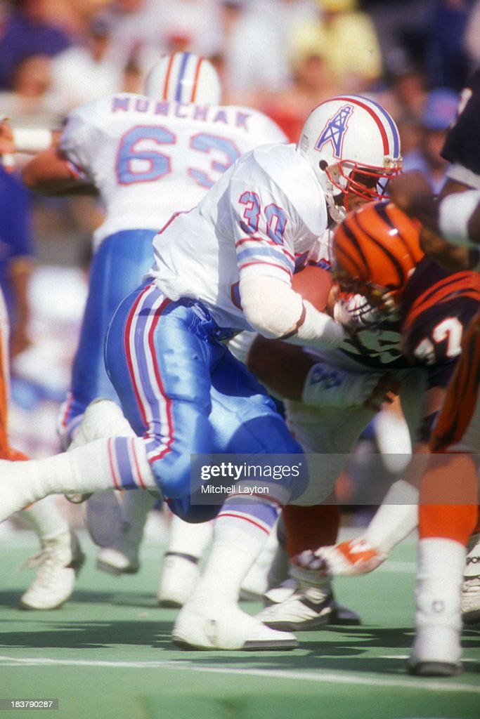 <a gi-track='captionPersonalityLinkClicked' href=/galleries/search?phrase=Mike+Rozier&family=editorial&specificpeople=622828 ng-click='$event.stopPropagation()'>Mike Rozier</a> #30 of the Houston Oilers runs with the ball during a football game against the Cincinnati Bengals on November 1, 1987 at Riverfront Stadium in Cincinnati, Ohio. The Oilers won 39-29.