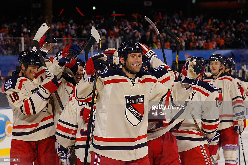 Mike Rupp #71 and the New York Rangers celebrate after defeating the Philadelphia Flyers by a score of 3-2 during the 2012 Bridgestone NHL Winter Classic at Citizens Bank Park on January 2, 2012 in Philadelphia, Pennsylvania.