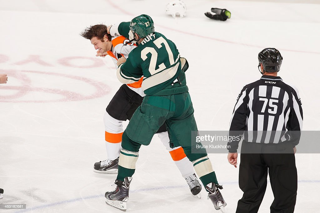 Mike Rupp of the Minnesota Wild fights with Jay Rosehill of the Philadelphia Flyers during the game on December 2 2013 at the Xcel Energy Center in...