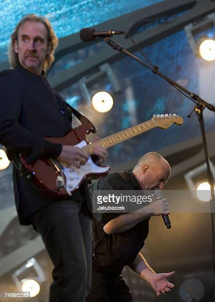 Mike Rutherfor and Phil Collins of the reunited band Genesis perform during a concert at the Olympiastadion on July 03 2007 in Berlin Germany The...