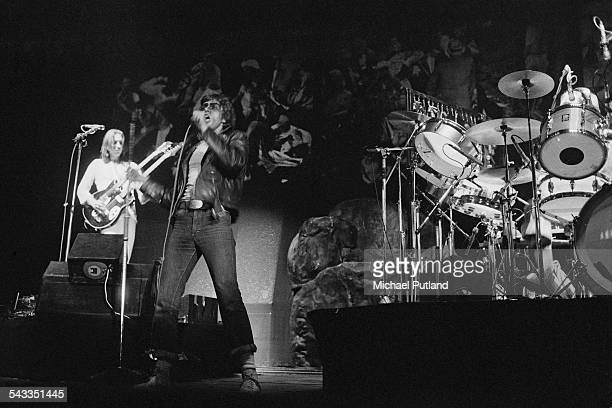 Mike Rutherford and Peter Gabriel performing with English progressive rock group Genesis at the Empire Pool London 14th15th April 1975