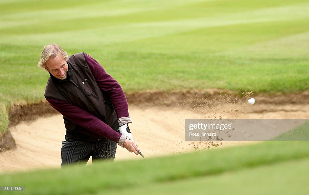 <a gi-track='captionPersonalityLinkClicked' href=/galleries/search?phrase=Mike+Rutherford&family=editorial&specificpeople=220193 ng-click='$event.stopPropagation()'>Mike Rutherford</a> hits from a bunker during the Pro-Am prior to the BMW PGA Championship at Wentworth on May 25, 2016 in Virginia Water, England.