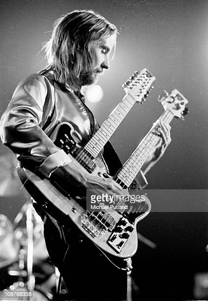 Mike Rutherford of Genesis playing a twinnecked bass guitar on stage in New York City in 1977