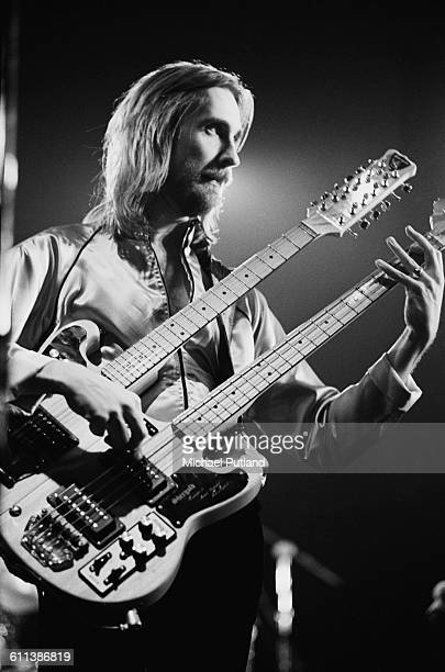 Mike Rutherford performing with English progressive rock group Genesis at the Broome County Veterans Memorial Arena Binghamton New York USA 28th...