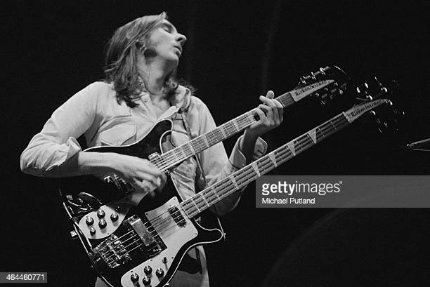 Mike Rutherford playing a Rickenbacker double neck guitar/bass during a performance with English progressive rock group Genesis at the Theatre Royal...