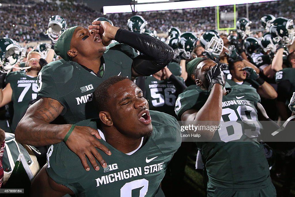 Mike Sadler and Lawrence Thomas of the Michigan State Spartans celebrates a win over the Michigan Wolverines at Spartan Stadium on October 25 2014 in...