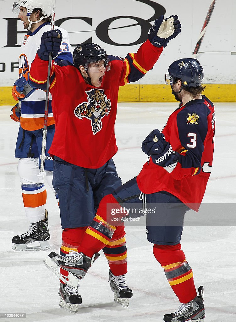 Mike Santorelli #13 congratulates TJ Brennan #3 after he scored his first goal with the Florida Panthers after he was traded from the Buffalo Sabres against the New York Islanders at the BB&T Center on March 16, 2013 in Sunrise, Florida. The Islanders defeated the Panthers 4-3.