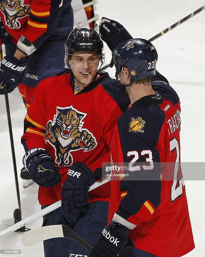 <a gi-track='captionPersonalityLinkClicked' href=/galleries/search?phrase=Mike+Santorelli&family=editorial&specificpeople=4517042 ng-click='$event.stopPropagation()'>Mike Santorelli</a> #13 is congratulated by <a gi-track='captionPersonalityLinkClicked' href=/galleries/search?phrase=Tyson+Strachan&family=editorial&specificpeople=5646502 ng-click='$event.stopPropagation()'>Tyson Strachan</a> #23 of the Florida Panthers after scoring the game winning goal against the Buffalo Sabres at the BB&T Center on March 28, 2013 in Sunrise, Florida. The Panthers defeated the Sabres 5-4 in a shoot out.