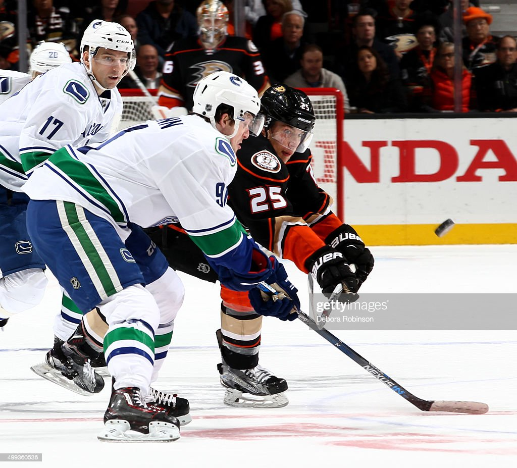 Mike Santorelli #25 of the Anaheim Ducks battles for the puck against Jared McCann #91 of the Vancouver Canucks on November 30, 2015 at Honda Center in Anaheim, California.
