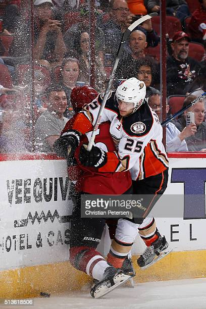 Mike Santorelli of the Anaheim Ducks lays a body check on Connor Murphy of the Arizona Coyotes during the second period of the NHL game at Gila River...