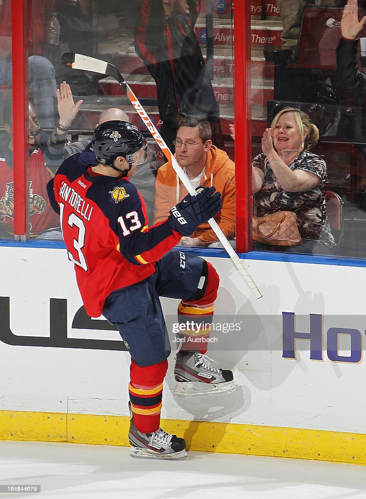 <a gi-track='captionPersonalityLinkClicked' href=/galleries/search?phrase=Mike+Santorelli&family=editorial&specificpeople=4517042 ng-click='$event.stopPropagation()'>Mike Santorelli</a> #13 of the Florida Panthers celebrates his game winning goal against the Buffalo Sabres in the shoot out at the BB&T Center on March 28, 2013 in Sunrise, Florida. The Panthers defeated the Sabres 5-4 in a shoot out.
