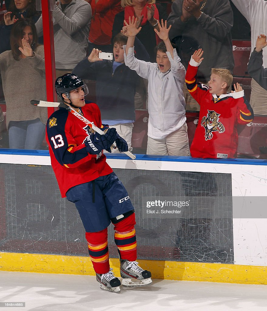 <a gi-track='captionPersonalityLinkClicked' href=/galleries/search?phrase=Mike+Santorelli&family=editorial&specificpeople=4517042 ng-click='$event.stopPropagation()'>Mike Santorelli</a> #13 of the Florida Panthers celebrates his game winning goal in a shot out against the Buffalo Sabres at the BB&T Center on March 28, 2013 in Sunrise, Florida.