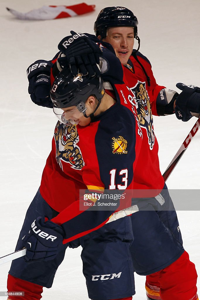 Mike Santorelli #13 of the Florida Panthers celebrates his game winning goal in a shot out with teammate Jerred Smithson #25 against the Buffalo Sabres at the BB&T Center on March 28, 2013 in Sunrise, Florida.