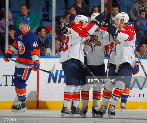 Mike Santorelli of the Florida Panthers celebrates his goal with teammates as Michael Grabner of the New York Islanders looks over during the second...