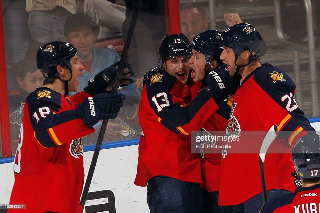 <a gi-track='captionPersonalityLinkClicked' href=/galleries/search?phrase=Mike+Santorelli&family=editorial&specificpeople=4517042 ng-click='$event.stopPropagation()'>Mike Santorelli</a> #13 of the Florida Panthers celebrates his goal with teammates against the New York Islanders at the BB&T Center on March 16, 2013 in Sunrise, Florida.