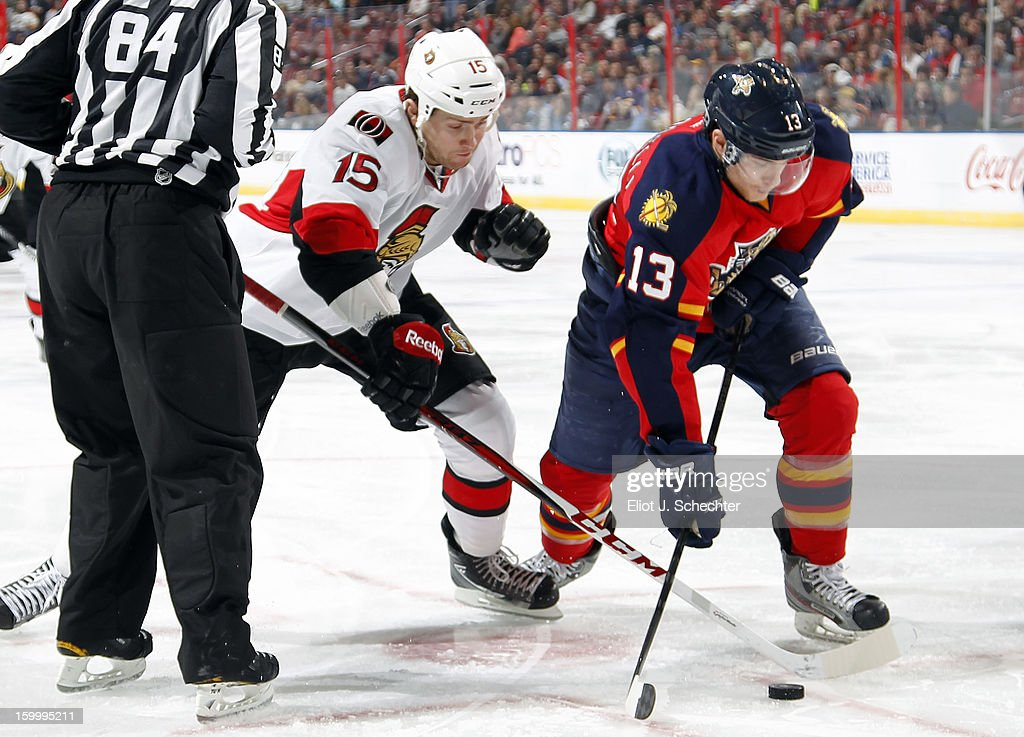<a gi-track='captionPersonalityLinkClicked' href=/galleries/search?phrase=Mike+Santorelli&family=editorial&specificpeople=4517042 ng-click='$event.stopPropagation()'>Mike Santorelli</a> #13 of the Florida Panthers faces off against Zack Smith #15 of the Ottawa Senators at the BB&T Center on January 24, 2013 in Sunrise, Florida.