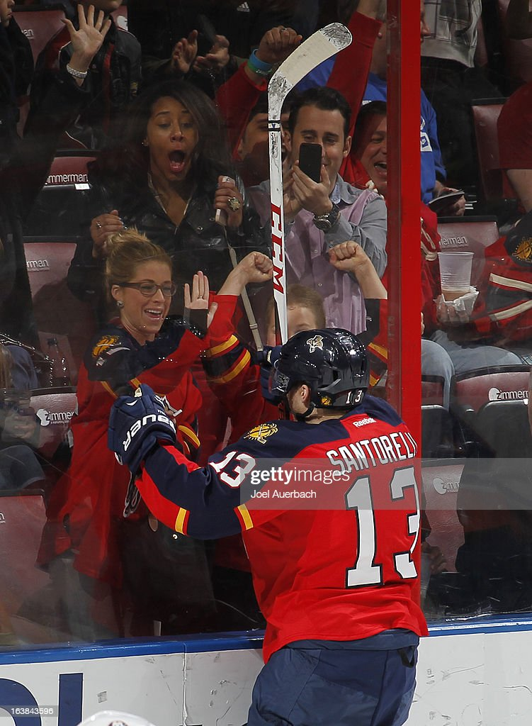 Mike Santorelli #13 of the Florida Panthers goes to the glass and celebrates his third period goal against the New York Islanders at the BB&T Center on March 16, 2013 in Sunrise, Florida. The Islanders defeated the Panthers 4-3.