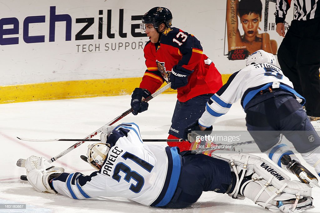 <a gi-track='captionPersonalityLinkClicked' href=/galleries/search?phrase=Mike+Santorelli&family=editorial&specificpeople=4517042 ng-click='$event.stopPropagation()'>Mike Santorelli</a> #13 of the Florida Panthers shoots and scores a goal against Goaltender Ondrej Pavelec #31 of the Winnipeg Jets at the BB&T Center on March 5, 2013 in Sunrise, Florida.